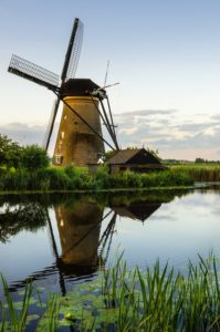 Typical Dutch Windmill and Reflectiona in Water