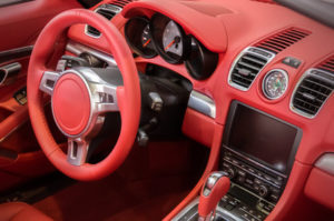 Red luxury car Interior - steering wheel, shift lever and dashbo